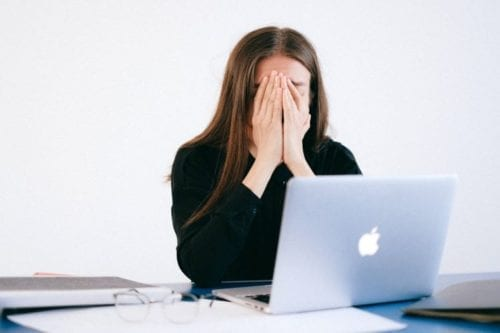 woman stressed in office